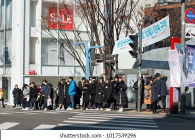 6 January 2018: A crowd is waiting to cross the street on the three way junction in front of H&M store in Hongdae, Seoul South Korea.