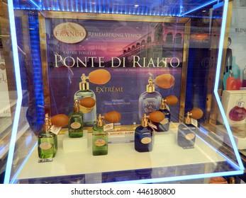6 JULY 2015 , Venice, Italy - Ponte Rialto perfume window shop showcase.