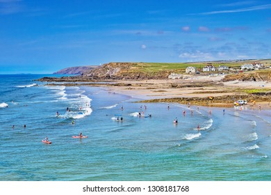 6 July 2018: Bude, Cornwall, UK - Crowds cooling off in the sea during the summer heatwave.