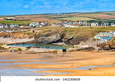 6 July 2018: Bude, Cornwall, UK - The beach and tidal swimming pool, with the town and hills beyond, during the summer heatwave. The hills are showing the effects of the summer drought.