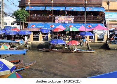 6 June 2019 Amphawa water market samutsongkram Thailand people travel in market thai language is mean papaya salad
