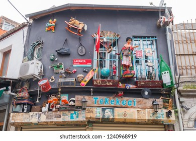 6 May 2018 Balat, Istanbul, Turkey: Strange design of the store. Toys on the walls of the building. Lavanta street, Terekeci shop. Chaos, installation, facade decoration. Garbage as an art object