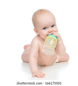 6 month child baby girl lying happy holding breastfeeding bottle nipple soother in hand on a white background