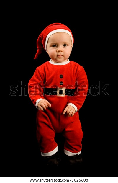 6 month old baby boy in a red santa or elf outfit