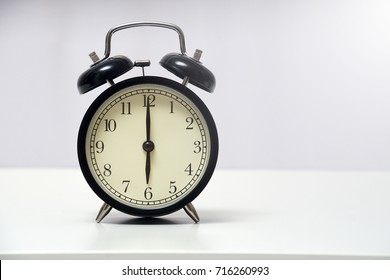 6 o'clock and 0 minutes over white background