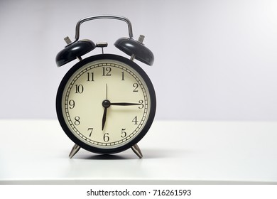 6 o'clock and 15 minute over white background