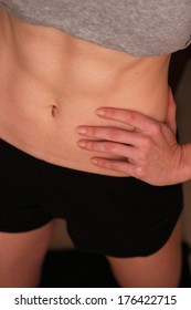 6 pack woman abs close up