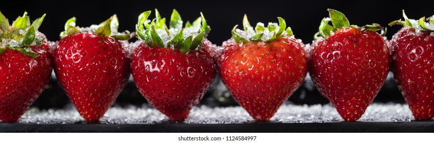 6 Ripe strawberries all in a line.