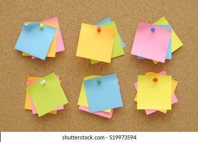 6 set colorful of sticky notes push pins on cork board