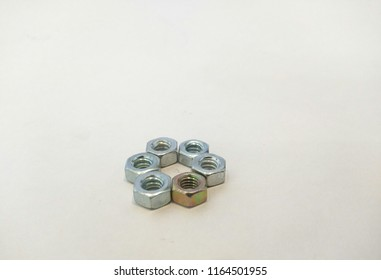 6 steel nuts arranged in a circular pattern