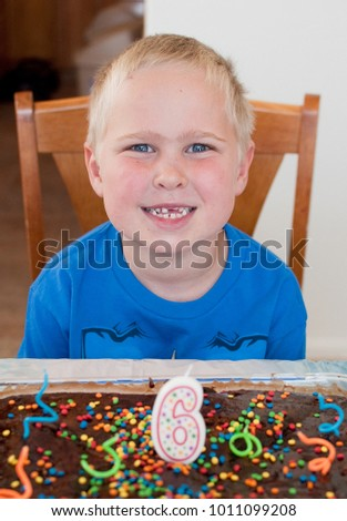 6 Year Old Boy With Birthday Cake