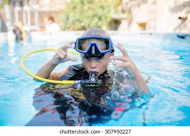 6 year old boy ready for scuba diving adventure