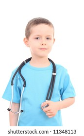 6 years old boy as a doctor isolated on white