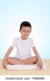 6 years old boy relaxing on blue background