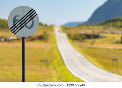 60 speed limit cancel road sign in Norway. Road travel by car in Scandinavia.