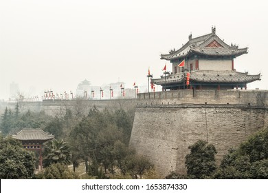 The 600 year history of the Ming Dynasty city wall tower and the forest around the city park in Xi'an, China-The text on the sign is Anyuan Dongyuan