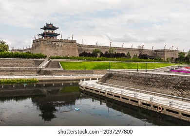 The 600 year old Ming Dynasty city wall in Xi'an, Shaanxi, China,the Ming city wall of Xi'an and the landscape of the park around the city in summer