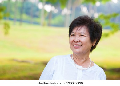 60's Asian senior woman at park in a morning