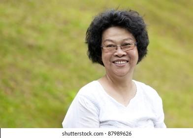 60's Asian senior woman at park in a morning
