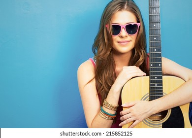 60s style photo of young hippie woman . musician girl