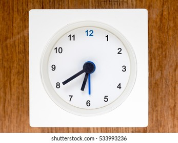 6:40 on the simple white analog clock