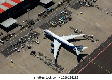 6-6-2016, Amsterdam, Holland. Aerial view at Schiphol Airport of a AirBridgeCargo Boeing 747 Jumbojet ready to get loaded with freight. ABC is a russian airline.