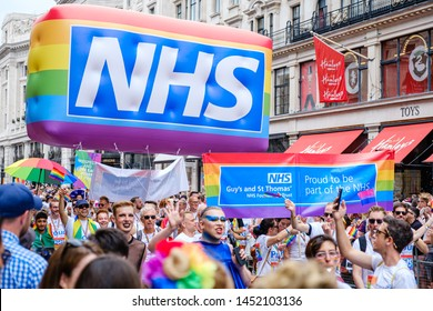 6th July 2019 - London, UK - The NHS staff from Guys and St Thomas' hospital walking down Regent Street as part of the 2019 London Pride festival with bright rainbow inflatable and NHS logo
