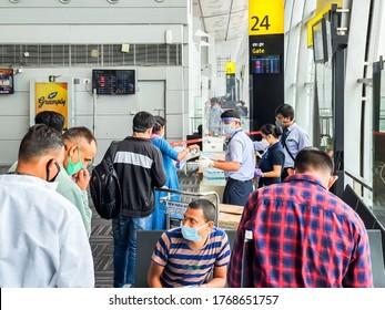 6th June 2020- Netaji Subhas Chandra Bose International Airport, Calcutta, India-Indigo Airlines staff provides passengers with personal protective equipments before boarding flights.