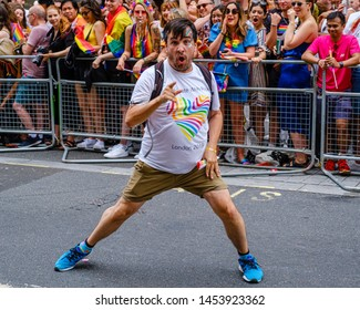 6th London 2019 - London, UK - An eccentric man wearing a Pride T-Shirt posing for cameras on Regent Street while taking part in the London 2019 Pride Festival and Parade