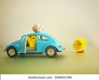 6th march 2018. Finland, Espoo. Easter holiday Illustrative editorial Toy car Volkswagen Beetle closeup image. Small chicken driving with egg on top of the car. Vintage car model. Old retro beetle
