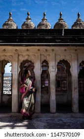 6th March 2018 Jodhpur India : indian woman walking on the historical Mehrangarh fort of Jodhpur in Rajasthan state in India during sunny day with traditional sari dress on