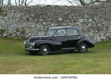 6th May 2019- A classic Morris Oxford four door saloon car, built in 1951, being driven at a vintage vehicle show at Carew Castle near Tenby, Pembrokeshire, Wales, UK.