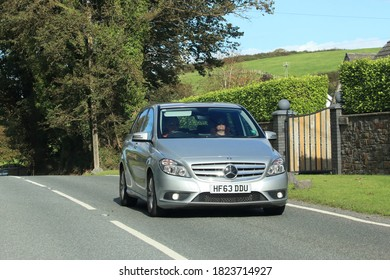 6th September 2020-A silver Mercedes-Benz B 180 Blueefficiency SE, five door hatchback car, being driven on a main road near Laugharne, Carmarthenshire, Wales, UK.