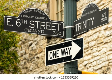 The 6th Street road sign. 6th Street is know for being the place to party in Austin, Texas. It's widely known for its live bands, bars, clubs, and street food.
