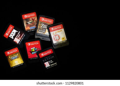 6th-July-2018 - Staffordshire - Nintendo Switch Game Cartirdges on a black background, feat Zelda, Mario Odyssey, Doom, Skyrim, LA Noire, Sonic Forces, Rayman Legends