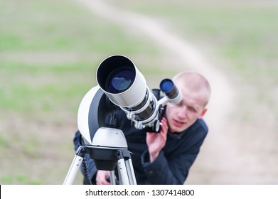 7 April 2015, Gomel, Belarus: Unknown young  astronomer looking skyward through astronomical telescope