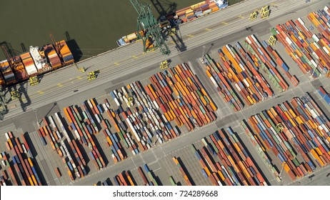 7 August 2017, Antwerp, Belgium. Aerial view of colourful containers in the harbour at river Schelde.