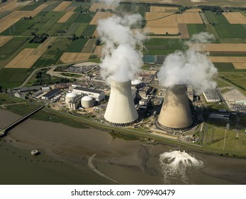 7 August 2017, Doel, Belgium. Aerial view of a nuclear powerplant at river Schelde, next to the harbour of Antwerpen. Smoke comes out of the chimney. Owner is Electrabel, part of Engie.
