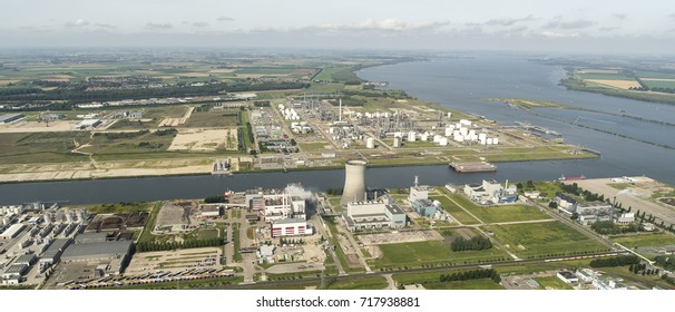 7 August 2017, Moerdijk, Holland. Aerial view of industrial area with Shell Chemicals, Attero and Essent. On the clear horizon a sky with clouds and river Hollands Diep.