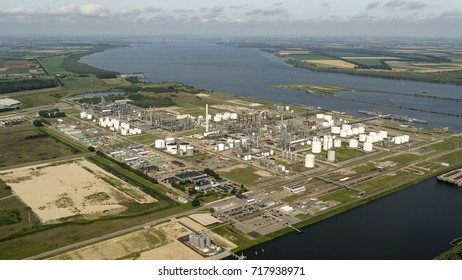 7 August 2017, Moerdijk, Holland. Aerial view of industrial area Shell Chemicals. On the clear horizon a sky with clouds and river Hollands Diep.