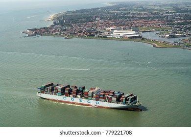 7 August 2017, River Westerschelde, Holland. Aerial view of Cosco containership. In the back the city of Vlissingen, Zeeland.