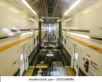 7 August 2019, Calais, France. Inside of the Euro Channel Tunnel Travelling with Eurotunnel le shuttle Lights, information and warning sings