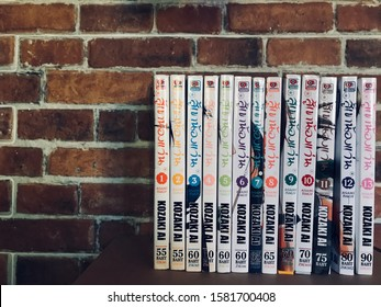 7 December 2019, Bangkok, Thailand: comic book on shelf, on brown brick wall background. Set of KOZAKI AI cartoon comic book in living room.