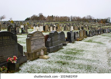 7 February 2018 Headstones in sombre contrast against the thin layer of snow in the Clandeboye Cemetery Bangor Northern Ireland on a cold winter morning
