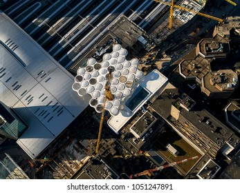 7 February 2018, Utrecht, Holland. Aerial shot of a modern rooftop at Hoog Catharijne at Central Station. A construction crane comes out of the roof. It is a futuristic view with white bubble circles.
