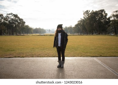 7 July 2017 - Canberra Australia: Young Asian Australian woman posing in front of the Parliament House.