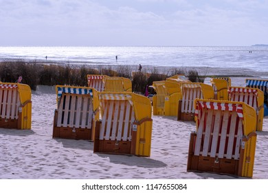 7 July 2018 - Cuxhaven, Germany. Yellow beach chairs on a sandy beach