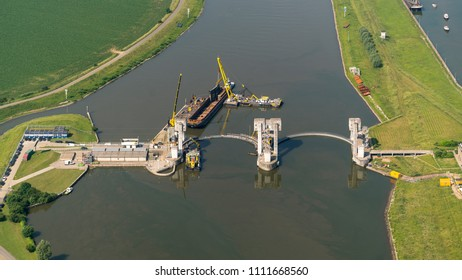 7 June 2018, Amerongen, Holland. Aerial view of construction work with working vessels at sluice lock and hydroelectric power plant in the river Nederrijn between Maurik and Amerongen in Netherlands