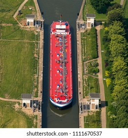 7 June 2018, Amerongen, Holland. Aerial view of big red ship, lng tanker Eureka, in a sluice lock in the river Nederrijn between Maurik and Amerongen, The Netherlands.