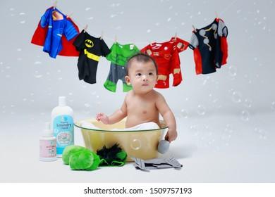 7 Oct 2017 Thailand  toddler studio portrait in concept super hero take a bath.